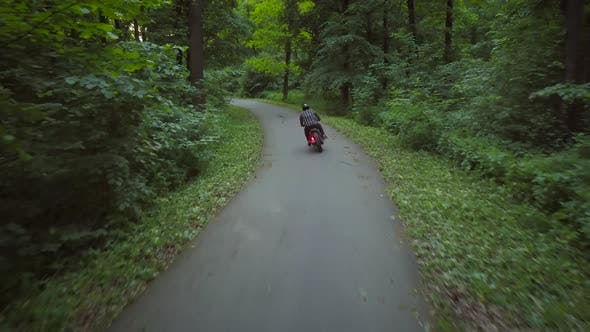 Thumbnail for Biker Riding a Motorcycle on a Road Surrounded By Trees