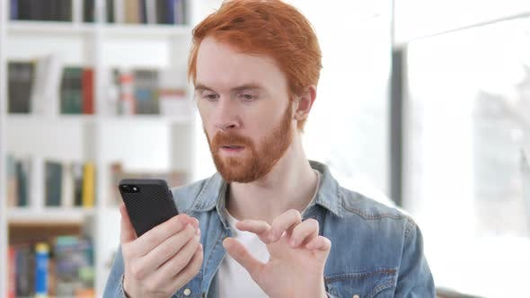 Thumbnail for Excited Man Enjoying Success While Using Smartphone
