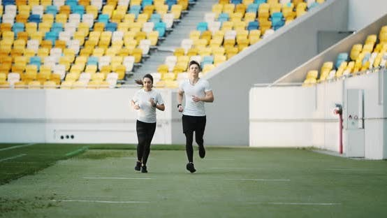 Thumbnail for Couple of Joggers on Stadium