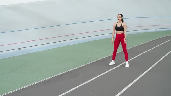 Thumbnail for Sporty Woman Exercising Outdoor at Stadium. Fitness Girl Doing Squat Exercises