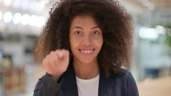 Thumbnail for Beautiful Young African Businesswoman with Pointing and Inviting