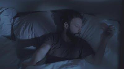 Sleep Disorder Night Insomnia Annoyed Man in Bed