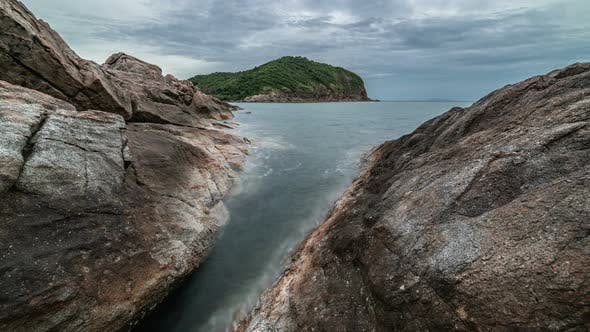Thumbnail for Dramatic rocky coastline at dusk and smooth sea wave