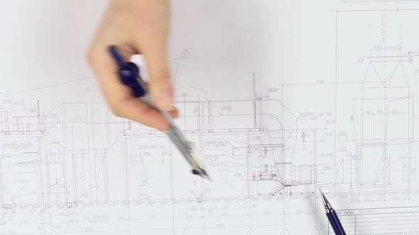 Thumbnail for Architects Are Sitting at the Table Analyzing the Drawing. Close Up