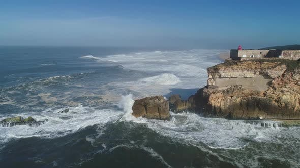 Thumbnail for Lighthouse on Cliff on Atlantic Ocean in Nazare