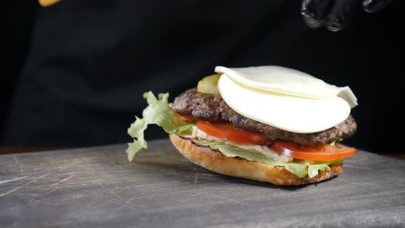 SLOW MOTION FOOD Concept. Chef Making Burger. Close-up . Burger Restaurant Menu Cooking Process
