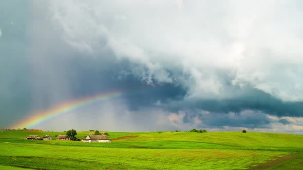 Thumbnail for Rural landscape, rain clouds and rainbow