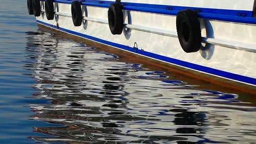 Ferryboat And Its Reflection On The Water