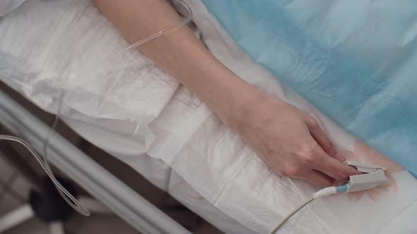 Oximeter on Finger of Patient