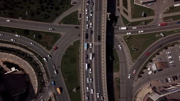 Thumbnail for Drone's Eye View -  Overhead Aerial View Of Traffic Driving Over A Modern Bridge