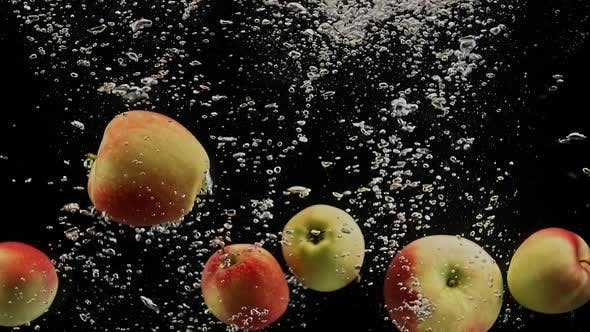 Thumbnail for Red Apples Falling in Water with Splash and Air Bubbles on Black Background