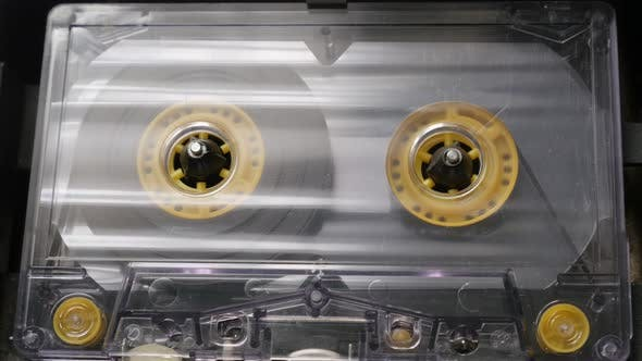 Thumbnail for Close-up of played   cassette in retro  casettophone  4K 2160p 30fps UltraHD footage - Supply spindl