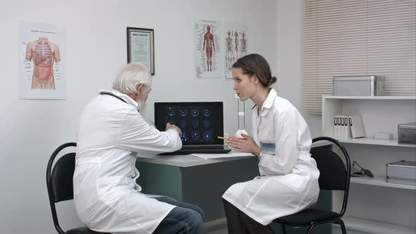 Thumbnail for Medical Doctors at Laptop Computer Discussing Patient's Scans.