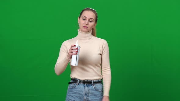 Depressed Frustrated Woman Pouring Whipped Cream in Mouth and Looking at Camera on Green Screen