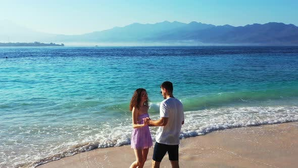 Thumbnail for Happy Boy and Girl Married on Vacation Have Fun on Beach on Paradise White Sand