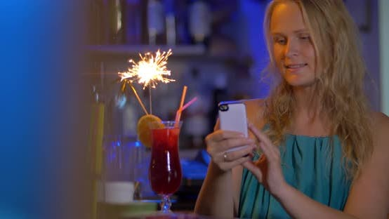 Cover Image for Woman Making Selfie with Cocktail and Sparkler