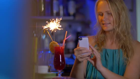Woman Making Selfie with Cocktail and Sparkler