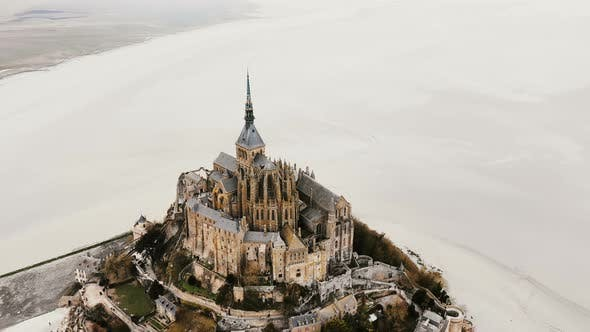 Thumbnail for Drone Zooming Out, Flying Up and Away From Mont Saint Michel Epic Island Abbey Landmark During Low