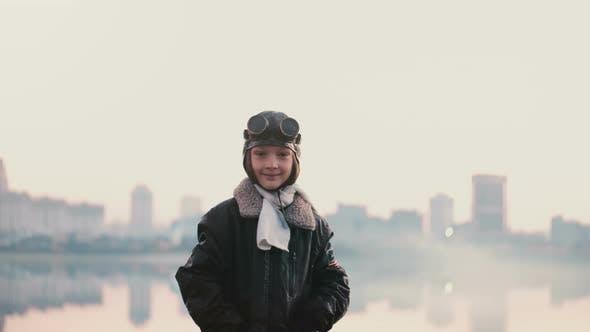 Thumbnail for Portrait of Little Girl in Old Pilot Costume on Sunset