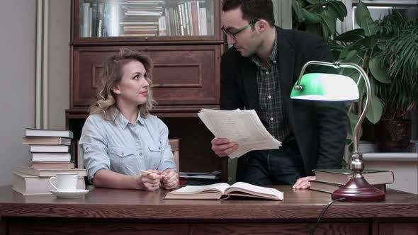 Thumbnail for Senior Male Worker in Glasses Holding Report and Explaining Tasks To Female Coworker