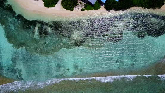 Tropical overhead travel shot of a white sand paradise beach and aqua turquoise water background in