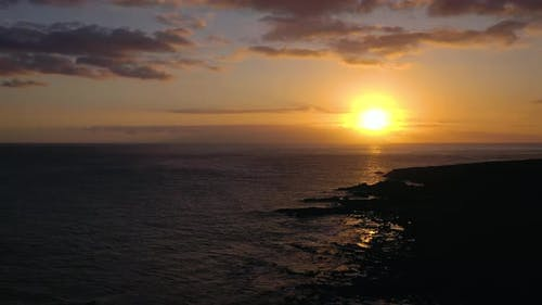 View From the Height of the Lighthouse Faro De Rasca, Nature Reserve and Dark Clouds at Sunset on