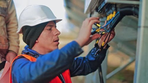Worker Checking Solar Cell System