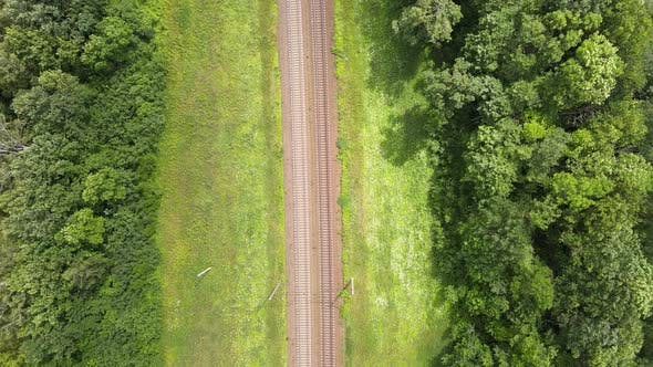 Thumbnail for Train Way, Railroad tracks Through Green Grassed Countryside, Aerial, Drone View.