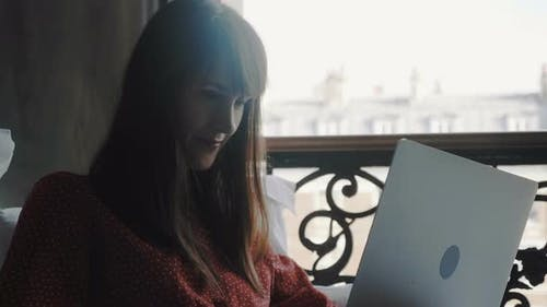 Freelance Work Concept, Happy Beautiful Smiling Caucasian Writer Woman Using Laptop in Bed