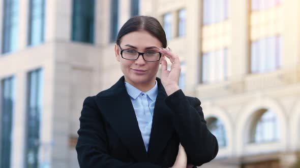 Young Business Woman Flirts, Takes Off Glasses and Smiles,  Attractive Brunette Office Employee