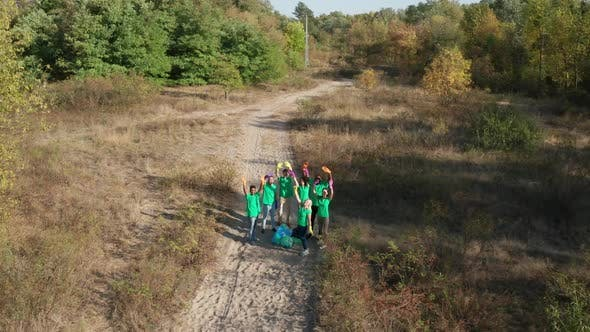 Thumbnail for Drone Flight Over Group of Volunteers Among Forest