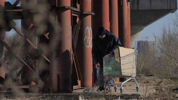 Thumbnail for Homeless Man Taking Plastic Bottle To Recycle
