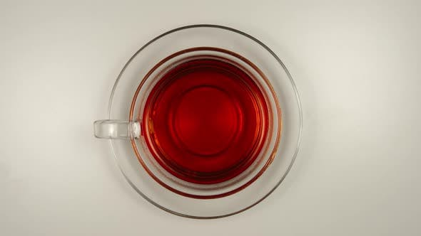 Thumbnail for Drinking a black tea from a glass tea cup