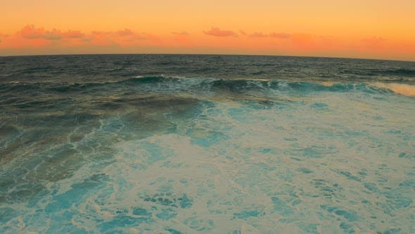 Thumbnail for Colorful Ocean Wave. Sea Water in Crest Shape. Sunset Light and Beautiful Cloudscape Sky