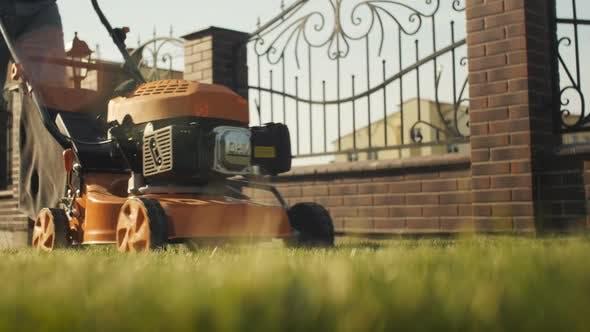 Thumbnail for Gardener Mows Grass