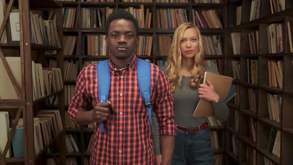 Modern Mixed Race Students in Public Library