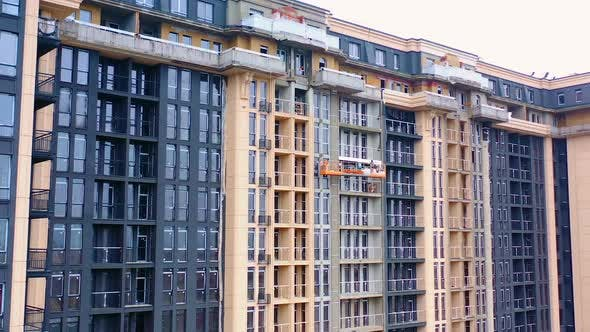 Construction of modern tower building. Exterior of a new architecture in the city.