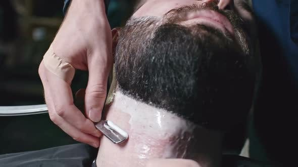 Thumbnail for Shaving Off Beard at Barber Place