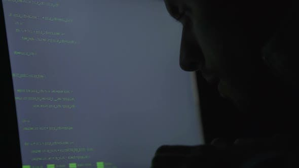 Man Hacking Website at Night, Typing Code to Breach the System, Cybercrime