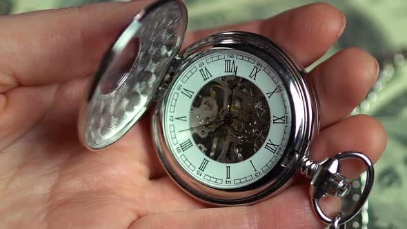 Thumbnail for Closeup view of pocket watch in male hands, minutes of precious life passing by