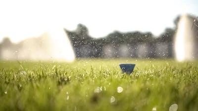 Golf Club Hits a Golf Ball