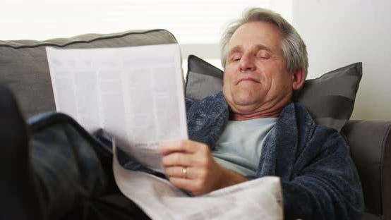 Thumbnail for Senior man falls asleep reading newspaper