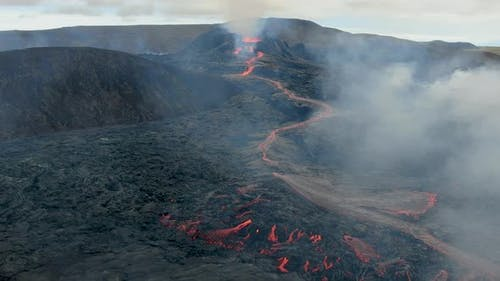Drone flying towards Fagradalsfjall erupting volcano in Geldingadalir, Iceland