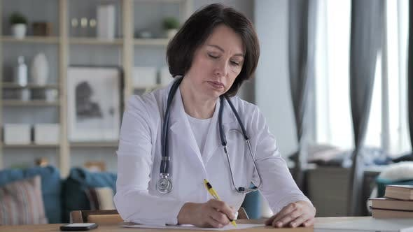 Thumbnail for Old Lady Doctor Writing Medical Report, Paperwork