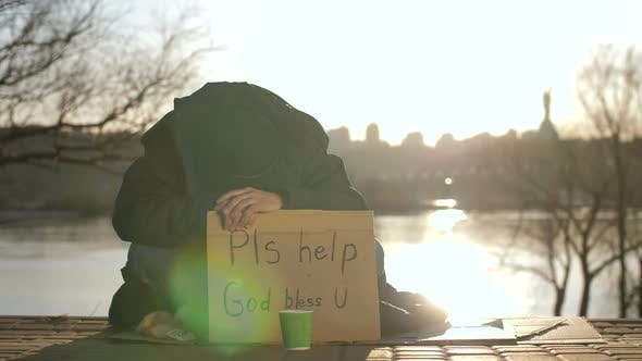 Thumbnail for Sad Beggar Sitting with Head Down Asking for Help