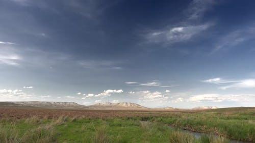 Brown Fields Between Mesa Hills in Soft Topography
