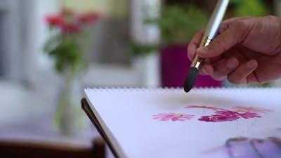 Artist's Hand Painting Flowers
