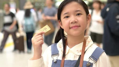 Asian Girl Showing Train Ticket While Travel In Japan