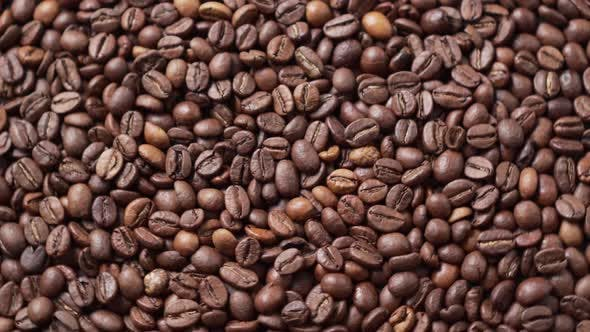 Dark Roasted Coffee Beans Move in a Circle.