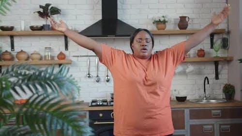 Body Positive Woman Practices Yoga Techniques Raising Arms